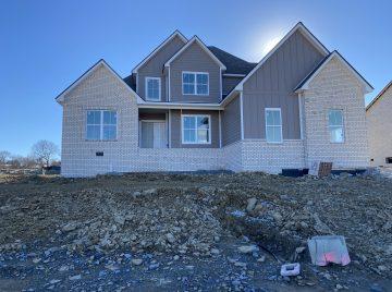 New custom home exterior under construction