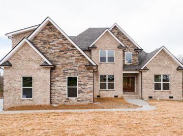 Brick and stone exterior of the Beaufort Plan custom home